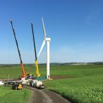 building wind turbines in a field