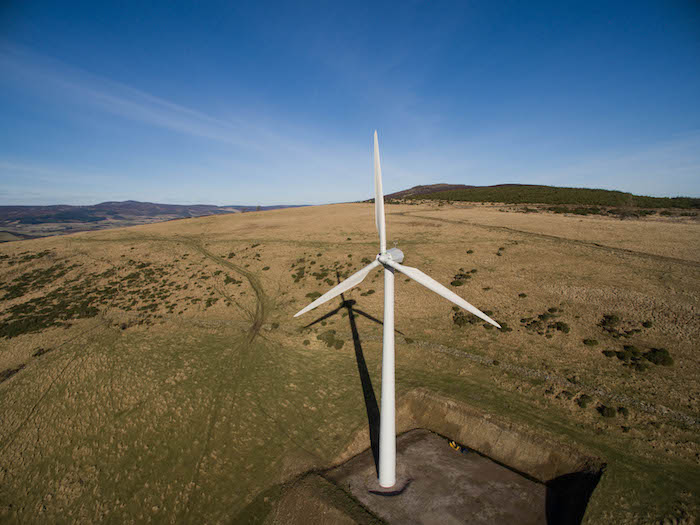 wind turbine on a hill top view